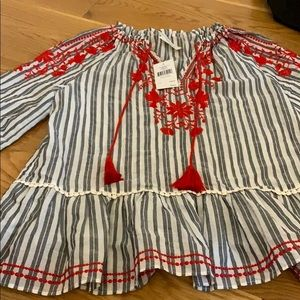 A blouse with red detailing